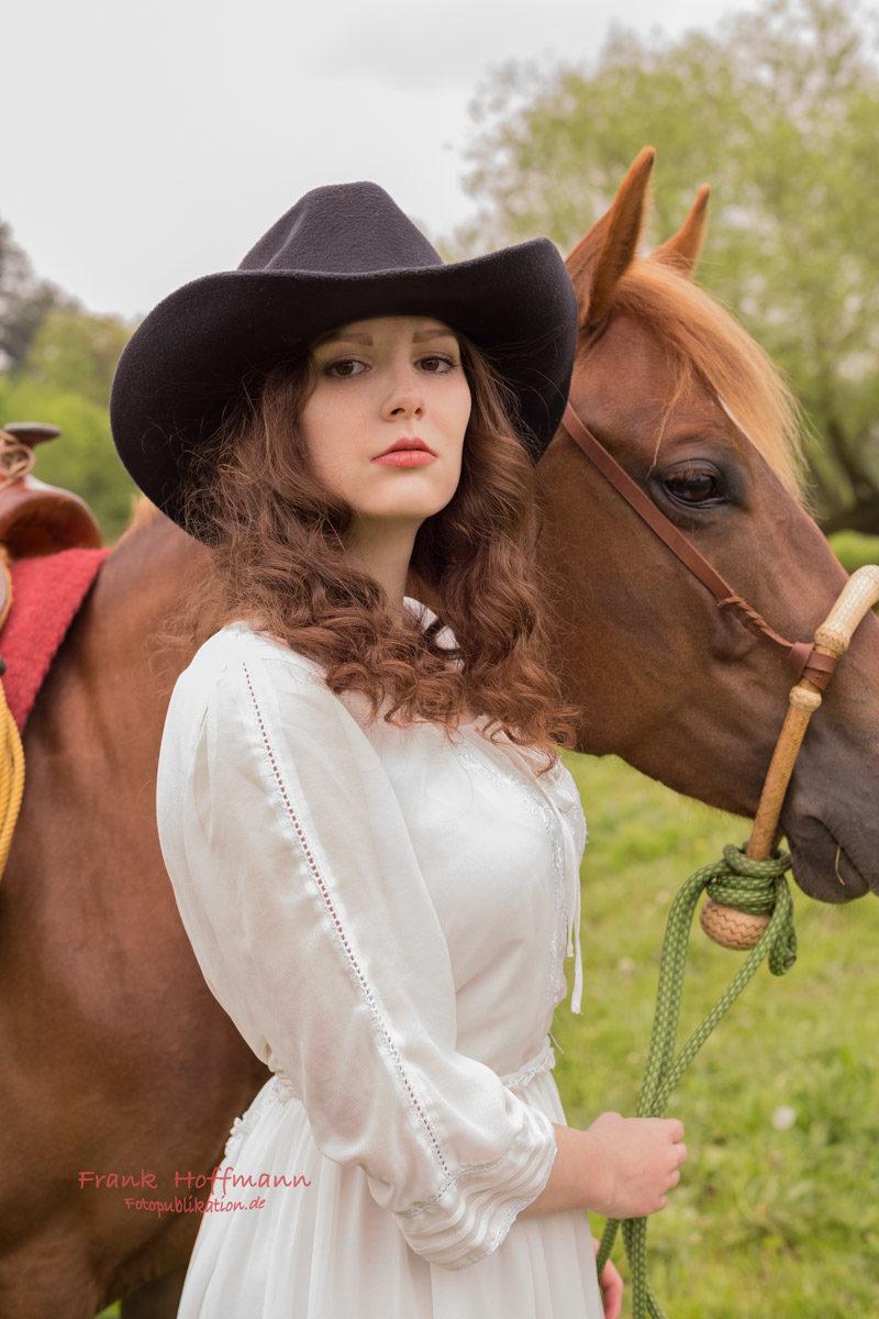 Cowgirl mit Hut.